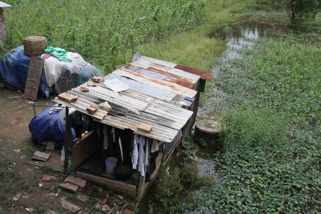 Cambodia's desperately poor live in homes such as this one.
