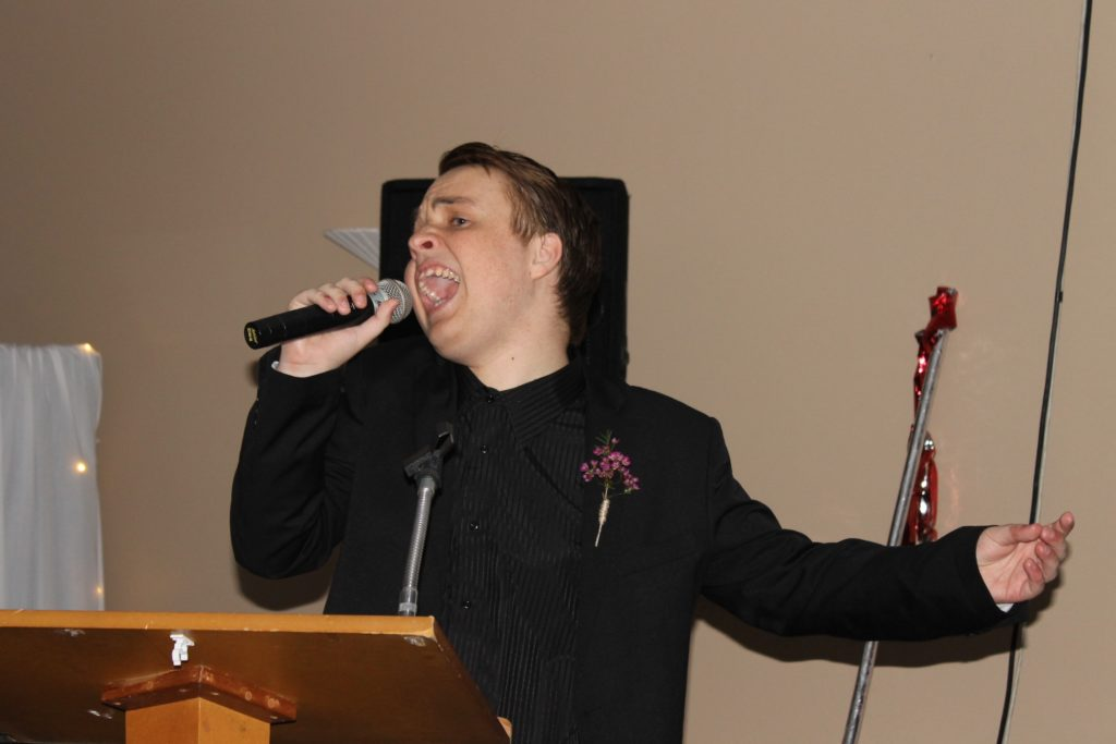 Sam hijacking the microphone to sing at his school ball.