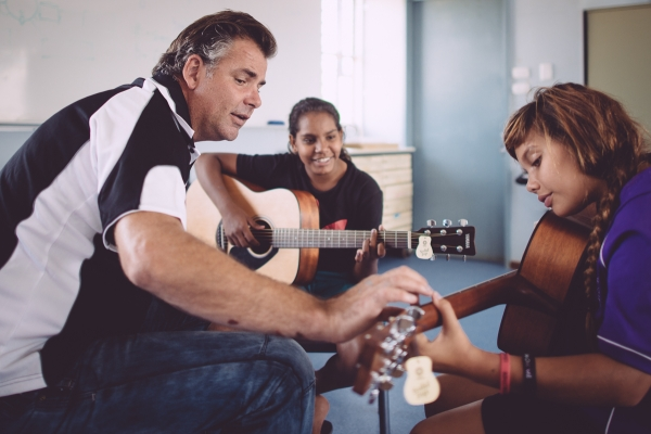 Qynn guides students in the art of guitar playing. Photo - Elements Margaret River