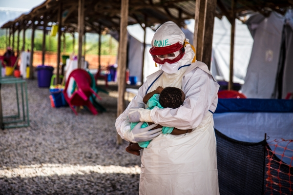 Anne with one of the many babies in the Ebola treatment centre. This one survived. Photo - Michael Duffy